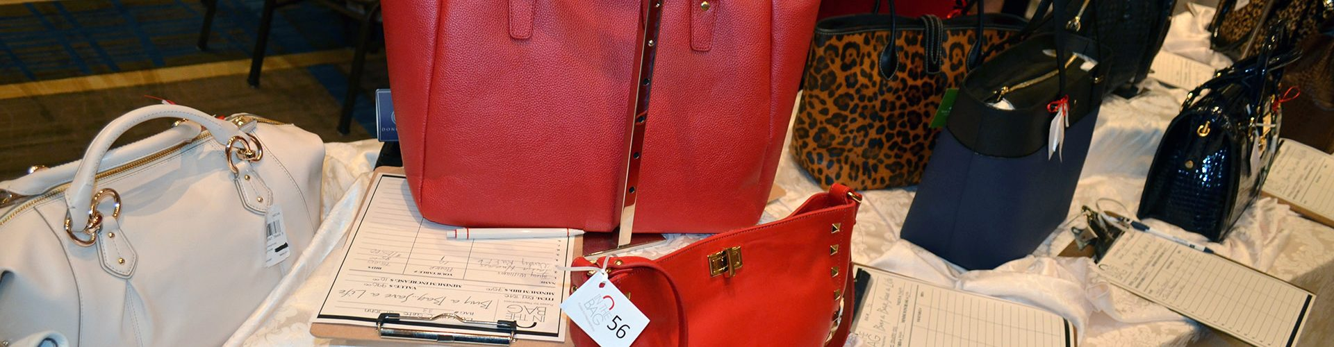 in-the-bag-2015-table-red-purses-1920